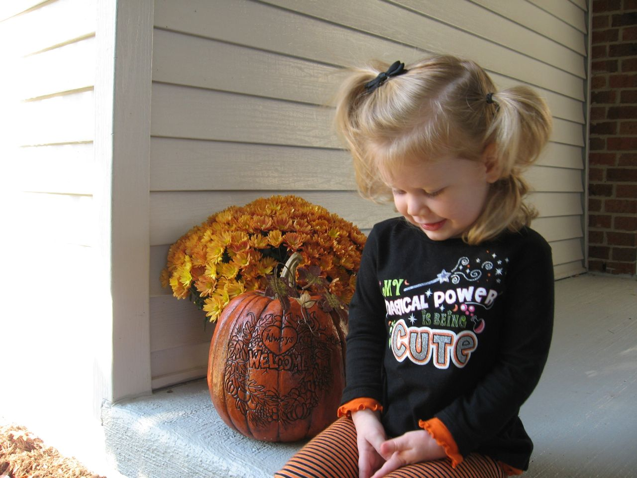 Amelia on the Porch Looking Cute